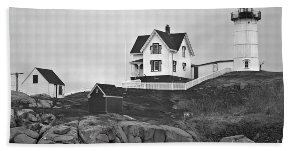 Nubble Lighthouse Bath Sheet featuring the photograph Nubble Lighthouse Cape Neddick Maine Black And White by Glenn Gordon