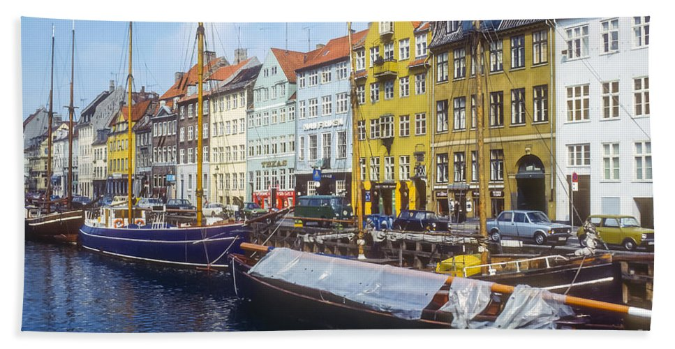 Nyhavn Canal Copenhagen Denmark Boat Dock Docks Boats Canals House Houses Building Buildings Structures Architecture Store Stores Shop Shops City Cities Cityscape Cityscapes Hand Towel featuring the photograph Nyhavn Boat Docks by Bob Phillips