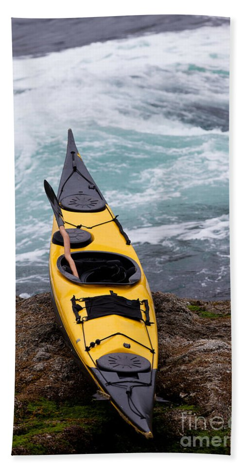 Activity Bath Sheet featuring the photograph Ocean Kayak Beached On Rocky Shore At Tidal Rapids by Stephan Pietzko