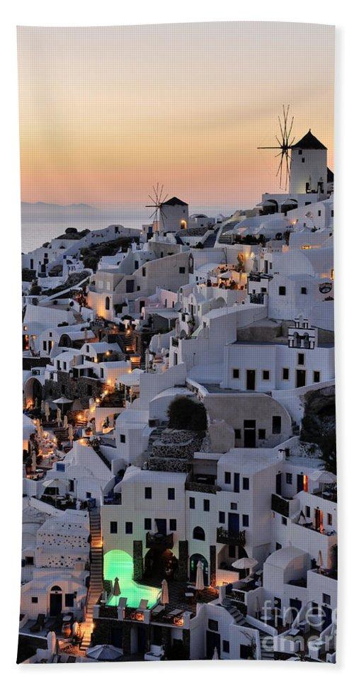 Santorini Bath Sheet featuring the photograph Oia Town During Sunset by George Atsametakis
