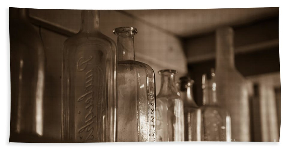 Colonial Hand Towel featuring the photograph Old Glass Bottles by Edward Fielding