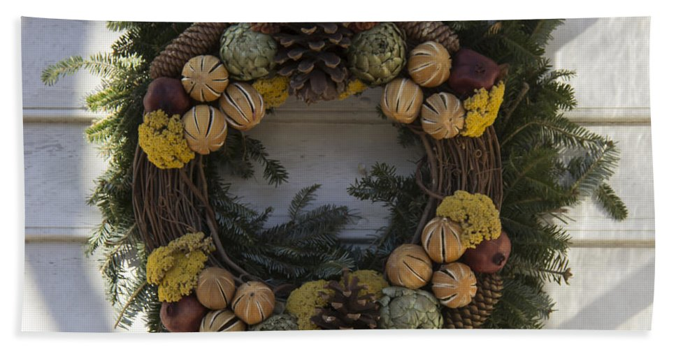 Colonial Williamsburg Hand Towel featuring the photograph Orange And Artichoke Wreath by Teresa Mucha