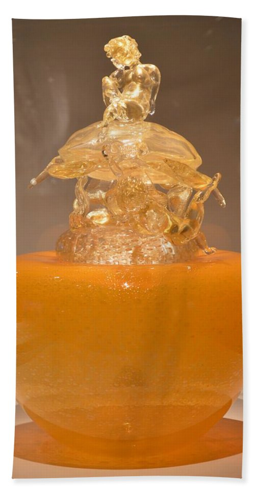 Orange Glass Sculpture Hand Towel featuring the photograph Orange Glass Sculpture by Sonali Gangane