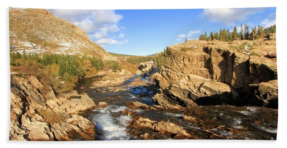 Glacier National Park Hand Towel featuring the photograph Over The Falls by Adam Jewell