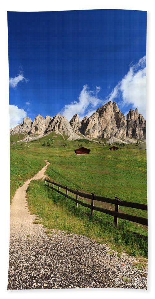 Alpine Hand Towel featuring the photograph path in Gardena pass by Antonio Scarpi
