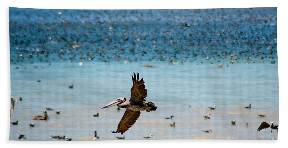 Flock Hand Towel featuring the photograph Pelicans Flocking On The Ocean by Toula Mavridou-Messer