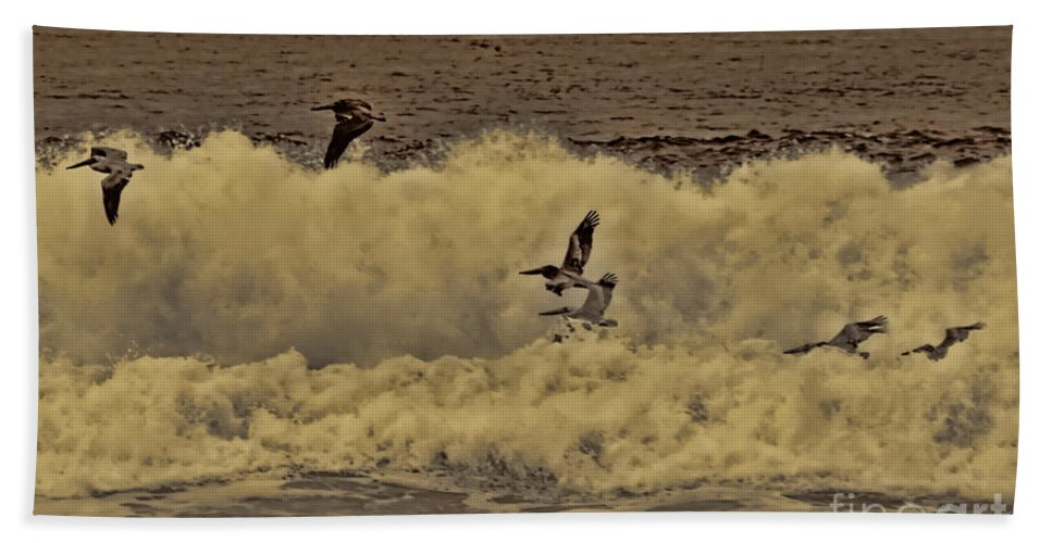 Pelicans Bath Sheet featuring the photograph Pelicans In The Surf by Tommy Anderson