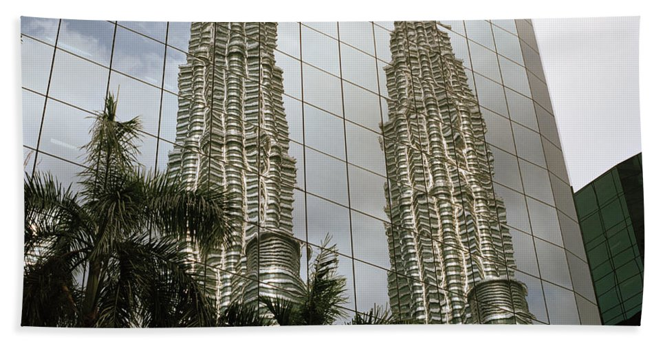 Petronas Towers Bath Sheet featuring the photograph Petronas Reflecting by Shaun Higson