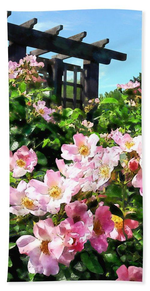 Rose Bath Sheet featuring the photograph Pink Roses Near Trellis by Susan Savad