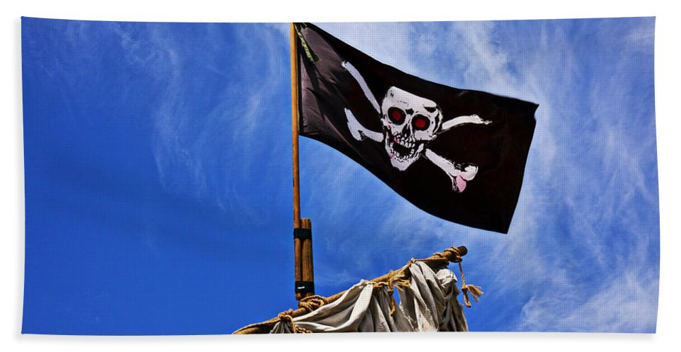 Pirate Flag Skull Banner Piracy Scull Robbers Terror Terrorist F Bath Sheet featuring the photograph Pirate Flag On Ships Mast by Garry Gay