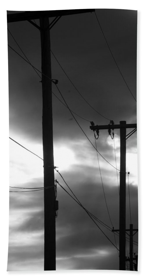 Scenic Hand Towel featuring the photograph Poles And Sunsets In Black And White by Rob Hans