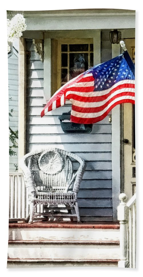 Flag Hand Towel featuring the photograph Porch With Flag And Wicker Chair by Susan Savad