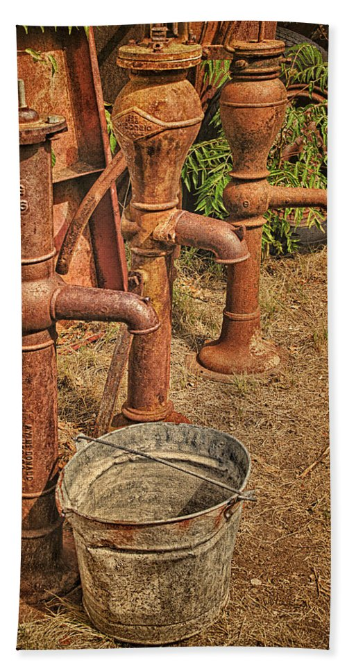 Water Pumps Hand Towel featuring the photograph Pumps Gone Dry by Priscilla Burgers