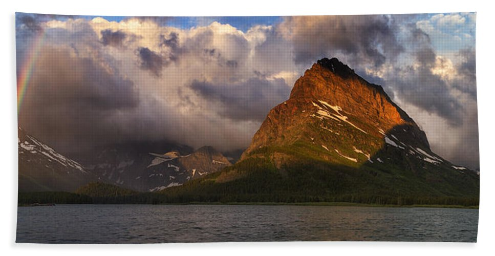 Many Glacier Hotel Hand Towel featuring the photograph Rainbow At Sunrise - Panorama by Mark Kiver
