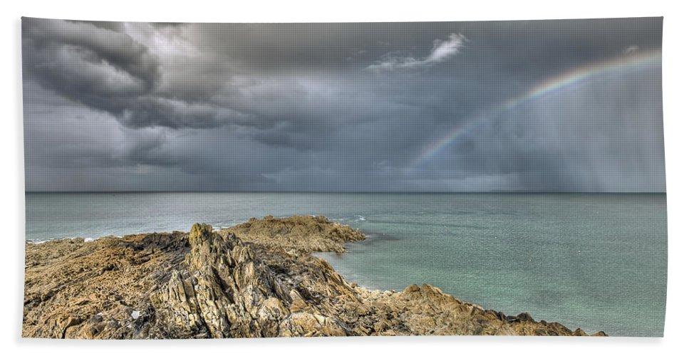 Rainbow Hand Towel featuring the photograph Rainbow In Storm Clouds Pointe De Saint Cast by Gary Eason