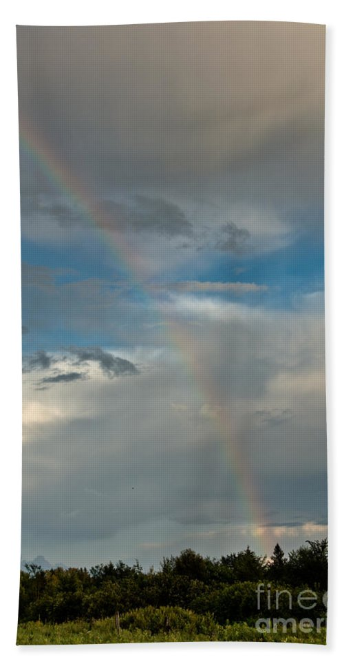 Rainbow Hand Towel featuring the photograph Rainbow Through The Clouds by Cheryl Baxter