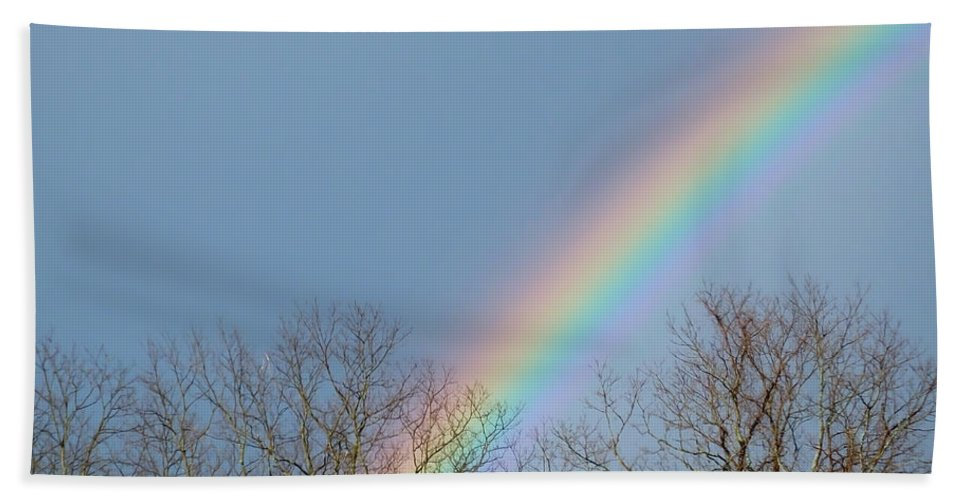 Artoffoxvox Hand Towel featuring the photograph Rainbow Through The Tree Tops by Kristen Fox
