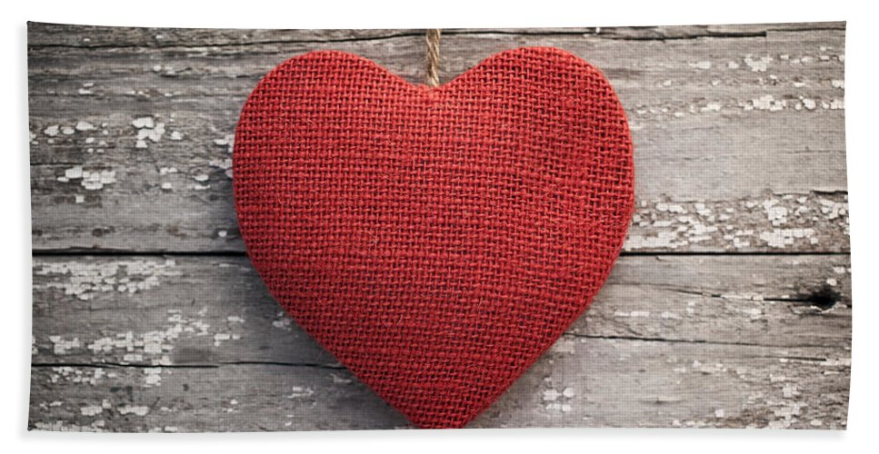 Antique Bath Sheet featuring the photograph Red Burlap Heart On Vintage Table by Leslie Banks