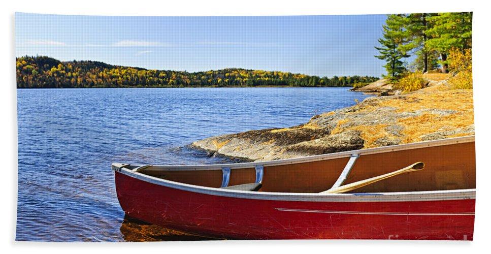 Canoe Bath Towel featuring the photograph Red Canoe On Shore by Elena Elisseeva