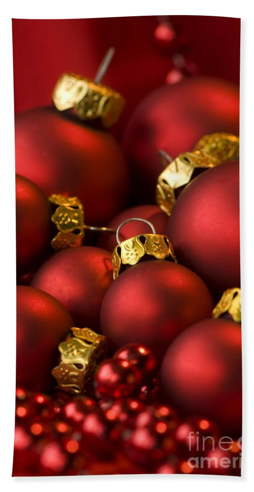 Baubles Hand Towel featuring the photograph Red Christmas Baubles by Anne Gilbert