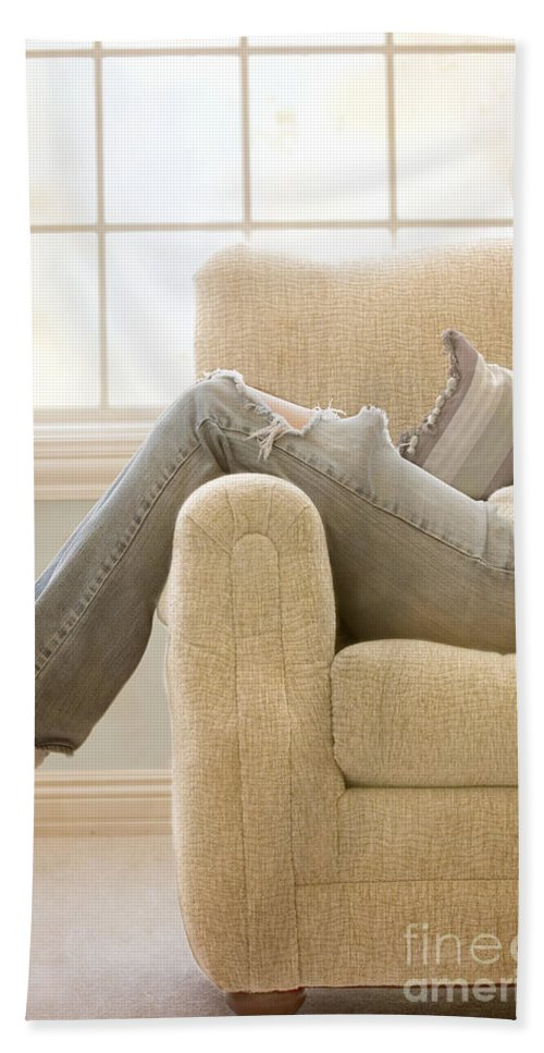 Woman; Lady; Female; Caucasian; Casual; Comfort; Comfortable; Lazy; Jeans; Socks; Sweater; Rips; Torn; Ripped; Hole; Chair; Sitting; Lounge; Lounging; Living Room; Indoors; Inside; Window; Wall; Carpet; Carpeting; Brunette; Crisp; Clean; Uncluttered; Sparse; Minimal; Alone; In Thought; Warm; Warmth Hand Towel featuring the photograph Relaxed by Margie Hurwich