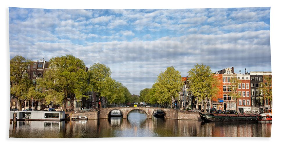 Amsterdam Bath Sheet featuring the photograph River View Of Amsterdam In The Netherlands by Artur Bogacki