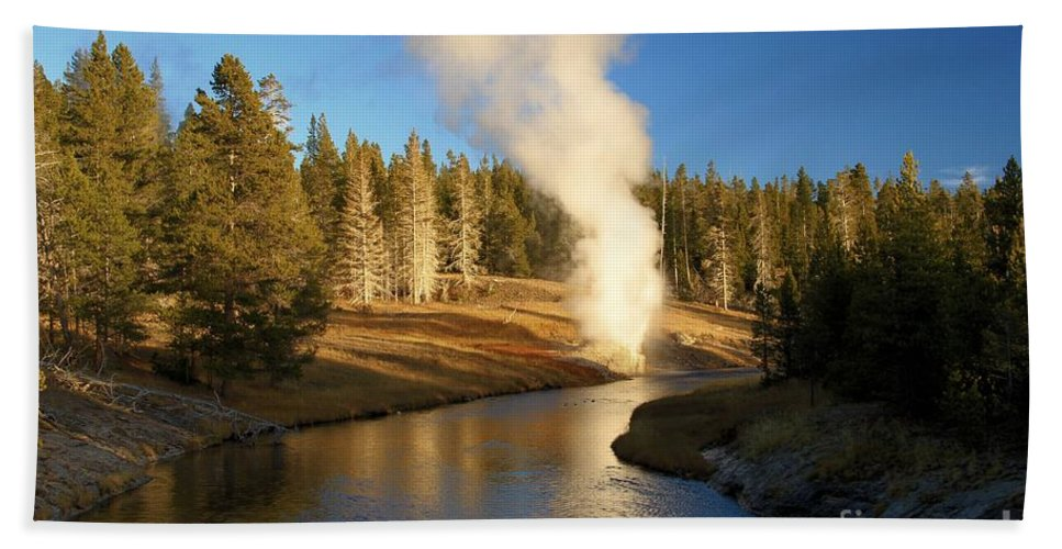 Riverside Geyser Hand Towel featuring the photograph Riverside Reflection by Adam Jewell