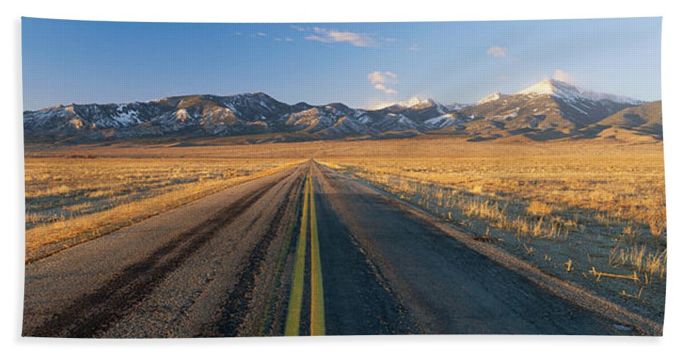 Photography Hand Towel featuring the photograph Road Through Desert by Panoramic Images