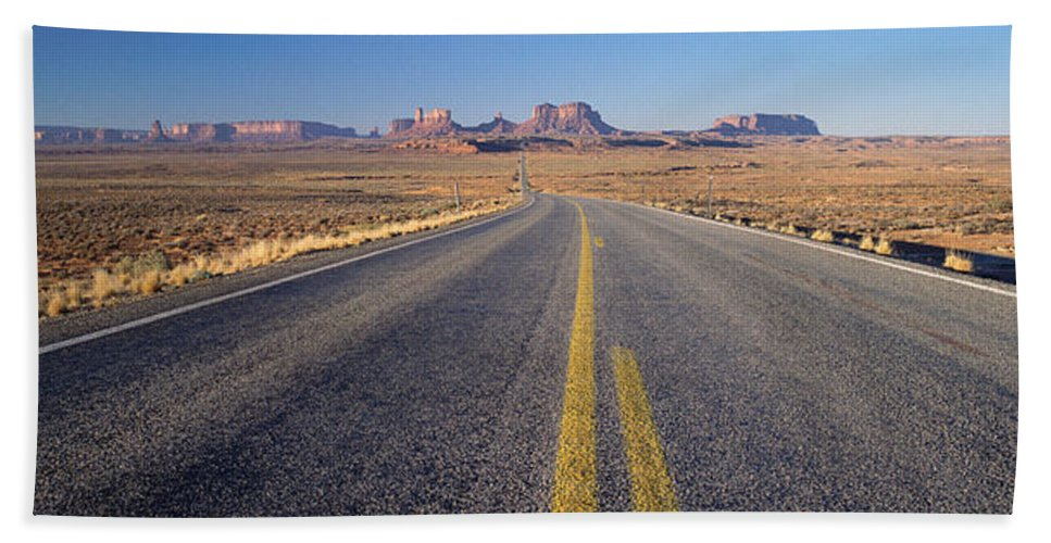 Photography Hand Towel featuring the photograph Road Through Monument Valley, Utah by Panoramic Images