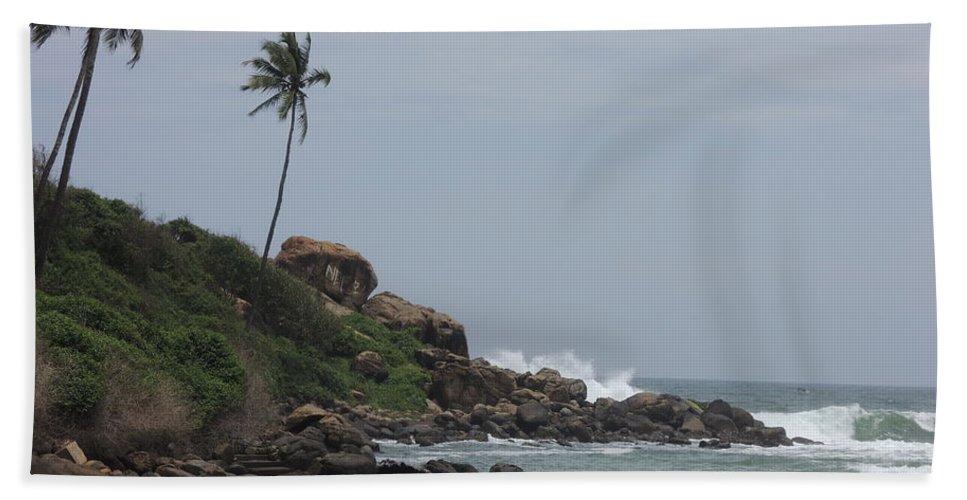 Rocks Of Kovalam Beach Kerala Bath Sheet featuring the photograph Rocks Of Kovalam Beach Kerala by Mini Arora