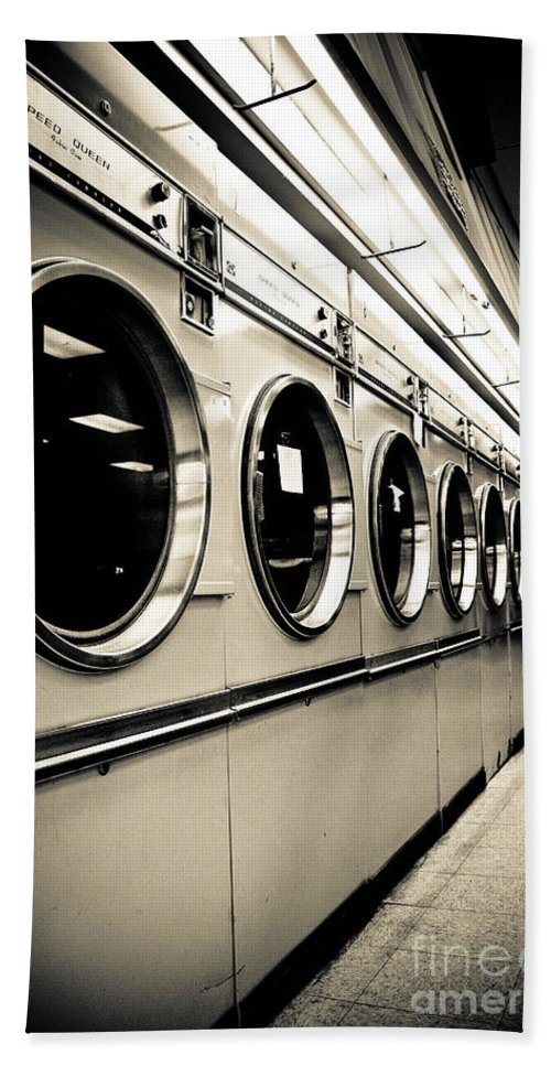 B&w Hand Towel featuring the photograph Row Of Washing Machines In Laundromat by Amy Cicconi