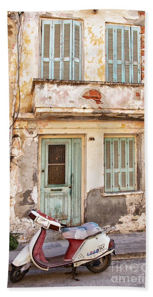 Moped Hand Towel featuring the photograph Run-down Building In Rethymnon by Sophie McAulay