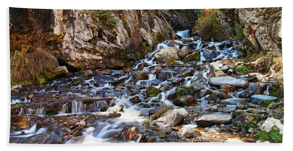 Rocks Bath Sheet featuring the photograph Running Through The Rocks by Jeff Swan