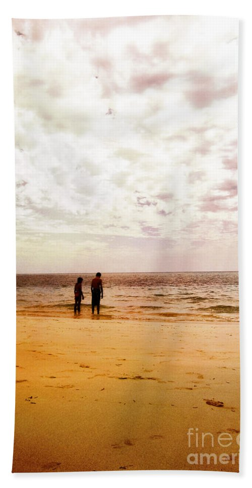 Couple; Two; Children; Sunset; Friends; Beach; Sand; Wading; Wade; Shallow; Calm; Serene; Water; Sea; Ocean; Lake; Horizon; Coast; Sky; Quiet; Outside; Outdoors; Paradise; Shore; Waves; Shoreline; Waters Edge; Blurry; Defocused; Male; Female; Boy; Girl Hand Towel featuring the photograph Sadly by Margie Hurwich