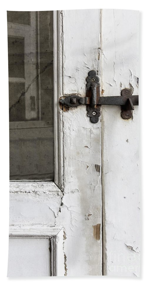 Ornate; Old; Building; Door; Doorway; Wood; Rustic; White; Peeling; Chipped; Painted; Rust; Metal; Closed; Aged; Entrance; Dirty; Facade; Grunge; Cracked; Handle; Keyhole; Rusty; Wooden; Beautiful; Lovely; Lock; Locked; Screen; Window; Reflection Hand Towel featuring the photograph Screen by Margie Hurwich