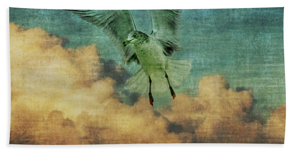 Bird Hand Towel featuring the photograph Seagull In The Clouds by Alice Gipson