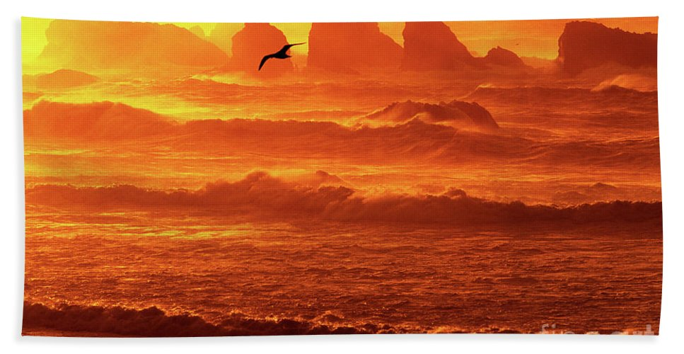 Oregon Hand Towel featuring the photograph Seagull Soaring Over The Surf At Sunset Oregon Coast by Dave Welling