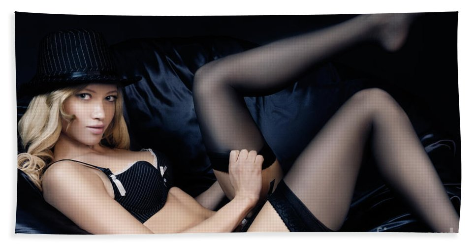 Stockings Hand Towel featuring the photograph Sexy Woman In Black Lingerie Putting On Stockings by Oleksiy Maksymenko