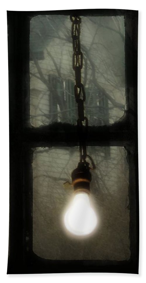 Old Light Bulb Bath Sheet featuring the photograph Lit Light Bulb Shines In Old Window by Gothicrow Images