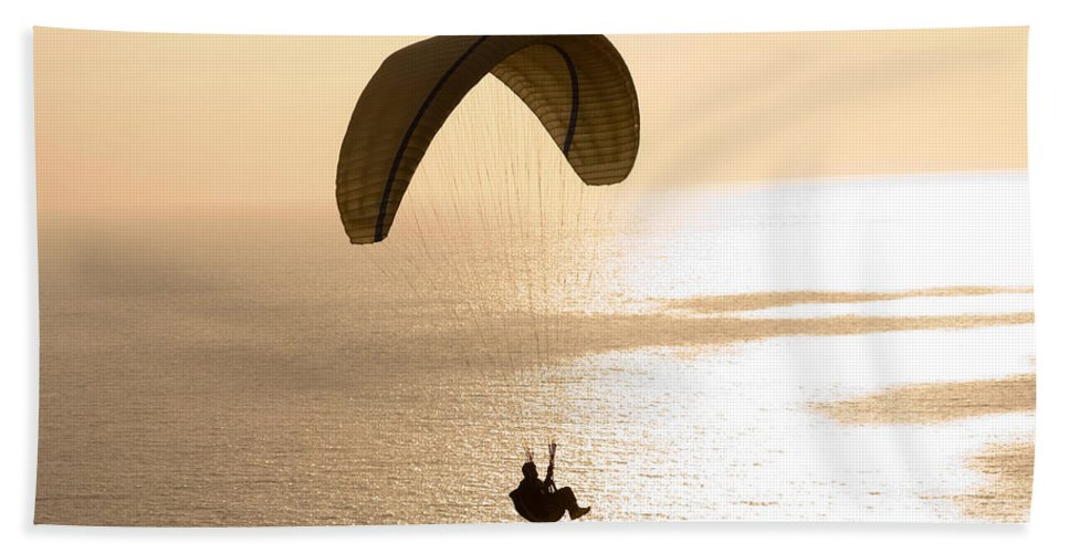 Photography Hand Towel featuring the photograph Silhouette Of A Paraglider Flying by Panoramic Images