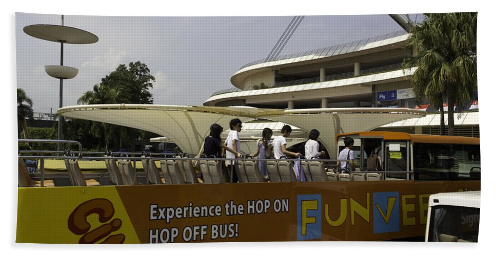 Action Bath Sheet featuring the photograph Singapore Flyer Along With The Sight-seeing Bus That Takes Tourists Around The City by Ashish Agarwal