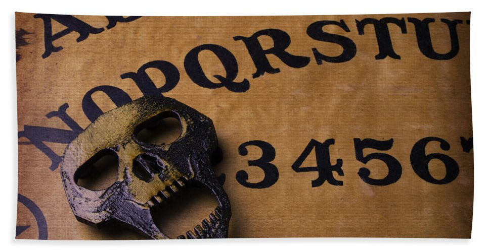 Darkness Hand Towel featuring the photograph Skull Planchette by Garry Gay