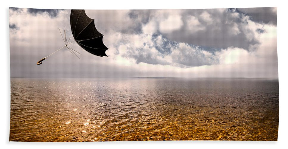 Umbrella Hand Towel featuring the photograph Slight Chance Of A Breeze by Bob Orsillo