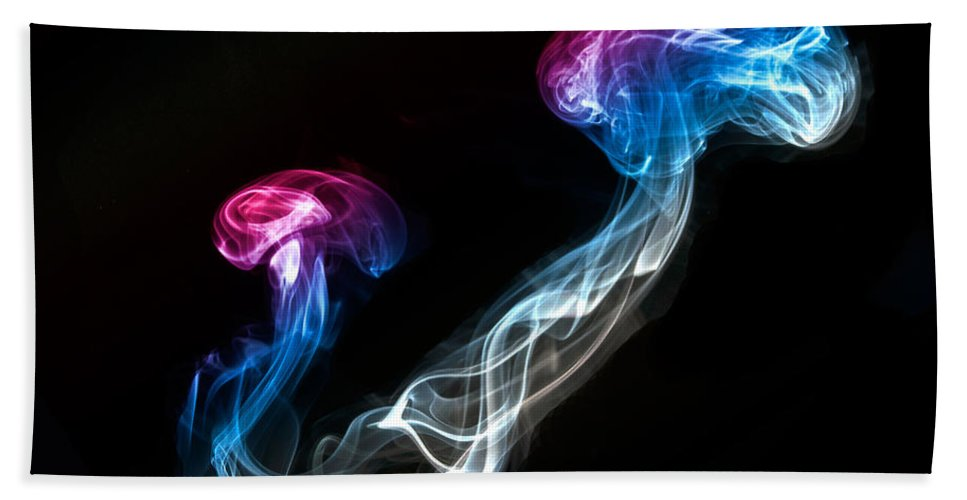 Smoking Trails Hand Towel featuring the photograph Smoked Jellyfish by Steve Purnell