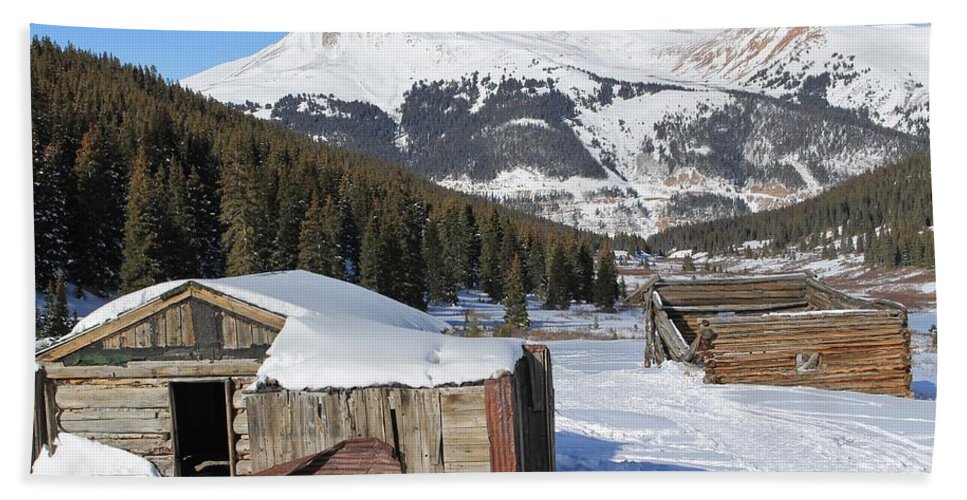 Nature Hand Towel featuring the photograph Snowy Cabins by Tonya Hance