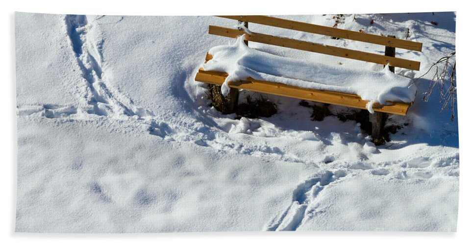 Background Hand Towel featuring the photograph Snowy Foot Prints Around Snow Covered Park Bench by Stephan Pietzko