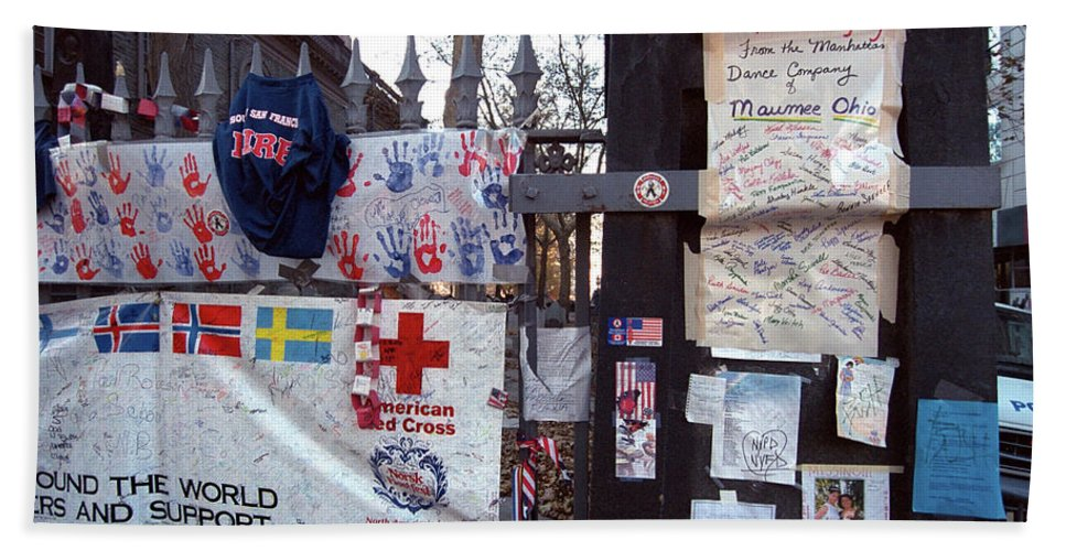 9-11 9/11 Sept. 11 2001 September Saint Paul's Chapel Finnish Flag Swedish American Tribute Memorial Fence Wrought Iron Fence Previously Unpublished Police Car Aftermath Nyfd Nypd Hand Towel featuring the photograph St. Paul's Chapel Memorial 9-11 by Steven Dunn