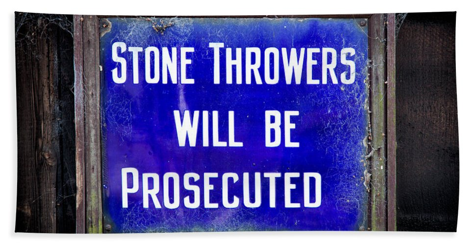 British Hand Towel featuring the photograph Stone Throwers Be Warned by Adrian Evans