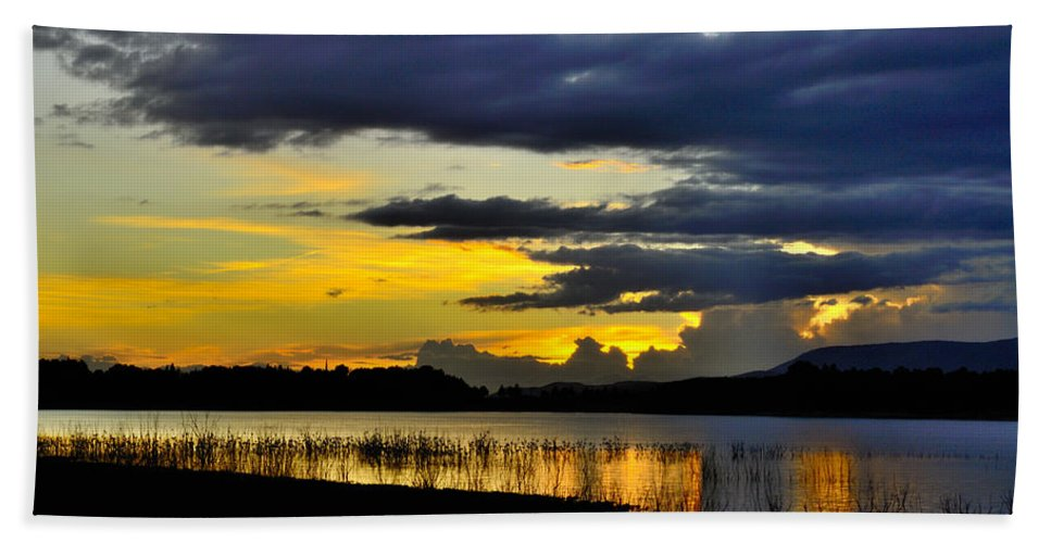 Sunset Bath Sheet featuring the photograph Storm At The Lake by Guido Montanes Castillo
