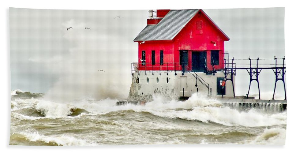Beach Hand Towel featuring the photograph Stormy At Grand Haven Light by Nick Zelinsky